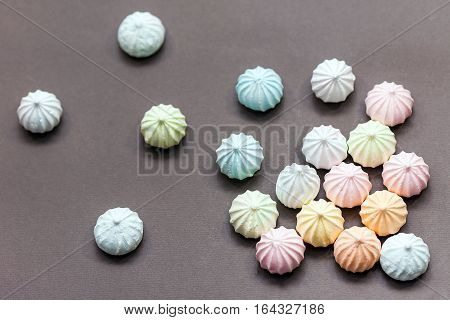 meringues in pastel colors on gray background