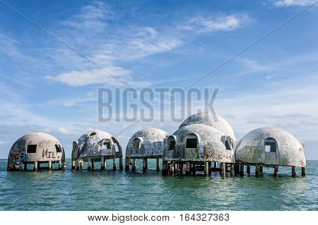 Cape Romano, Florida, USA - December 26, 2016 - The once self-sustaining dome home of Cape Romano is now home to marine life as years of shoreline erosion has put it out to sea.