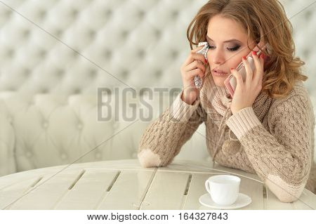 Portrait of crying young woman with the phone