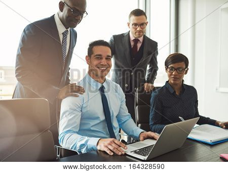 Group Of Four Young Business People In Office