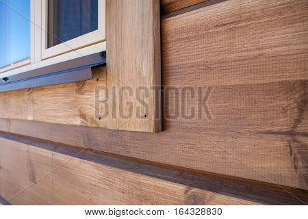 New wooden house detail. Natural wood house close up.