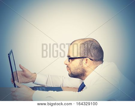 Tired Businessman Looking In A Computer.
