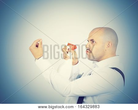 Male Cleaning Worker Spraying Liquid Detergent In Front Of Him,