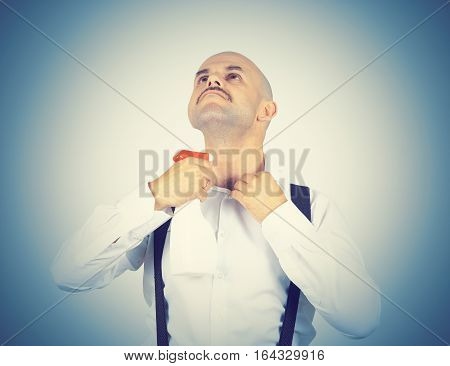 Bald Man Uses Deodorant From A Trigger.