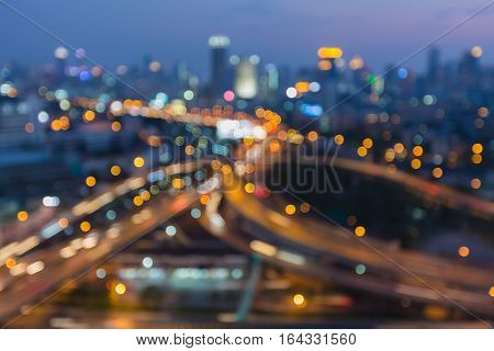 Night blurred lights Highway interchanged with city downtown abstract background