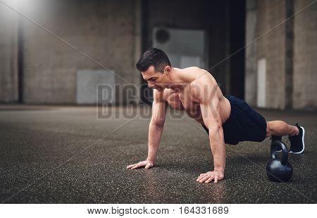 Full Length Shot Of Man Doing Push-ups