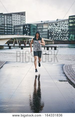 Fit And Healthy Man Running In Rain