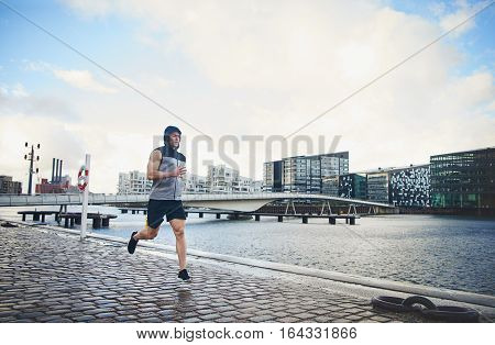 Side View Of Man Running Down Street