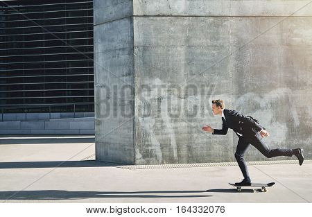 Businessman On A Skateboard Moving Forward Fast
