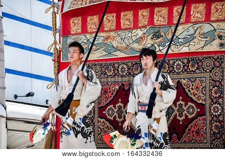 Kyoto Japan - July 17 2011: Japanese young men directing the float in the Gion Festival Parade Kyoto Japan
