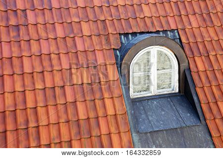 garret window on a roof of the old house