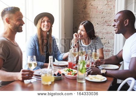 Group Of Young People Dining At Restaurant
