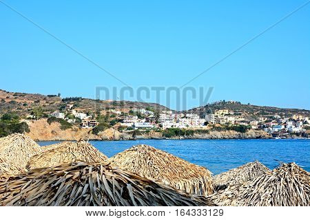 BALI, CRETE - SEPTEMBER 16, 2016 - Thatched parasols on Livadi Beach with views along the coastline Bali Crete Greece Europe, September 16, 2016.