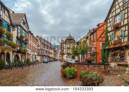 Main street with historical houses in Kaysersberg Alsace France