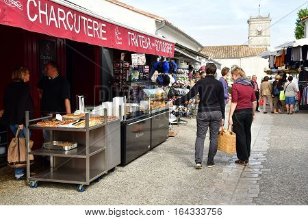 Le Bois Plage en Re France - september 27 2016 : pork butcher at the market
