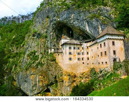 Postojna, Slovenia - View of the Predjama Castle, a renaissance castle partly built within a cave mouth and now serves as a famous tourist destination in Postojna, Slovenia.