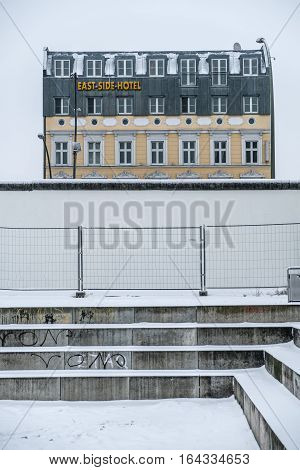 Berlin Germany - January 8 2017: The East Side Hotel behind the Berlin Wall / East Side Gallery the longest section of the Berlin Wall.
