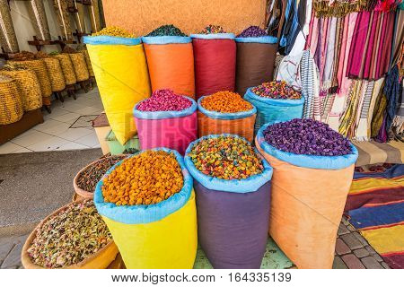 Lot of different herbs and spices on the market in Marrakech Morocco