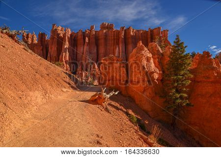 The hoodoos are shaped by weathering and erosion in desert climates.