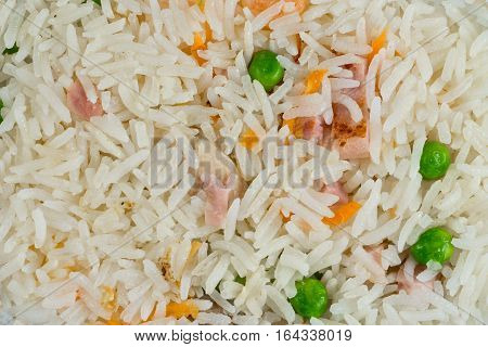 Meal background. Oriental rice dish with mixed meat boiled egg fresh vegetables like peas and carrot. Traditional Thai Food.
