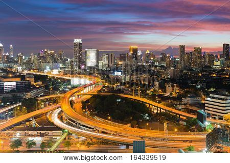 Dramatic sky after sunset over Bangkok city downtown and highway intersection long exposure Bangkok Thailand