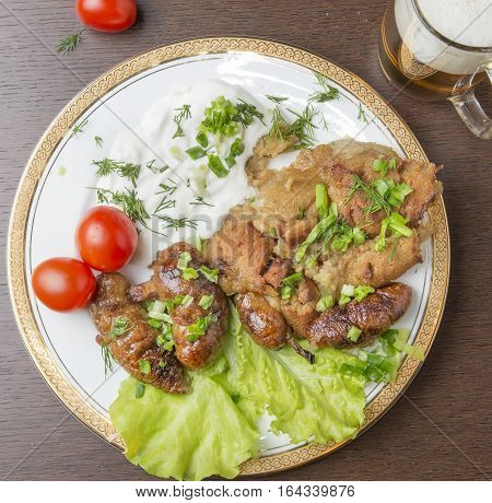 Potato Grandma And Sausages From Potatoes With Fat And Meat