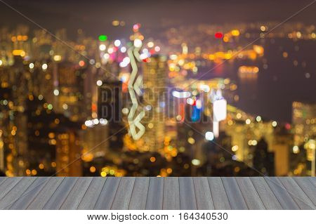 Opening wooden floor abstract blurred lights Hong Kong city over Victoria Bay