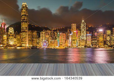 Opening wooden floor Hong Kong city blurred lights night view