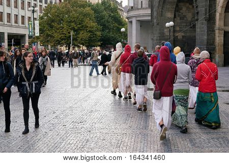 PRAGUE, CZECH REPUBLIK - OCTOBER 19, 2016: Hare Krishna followers walk through the Old Town of Prague. This Religion, was born in India and has adherents all over the world