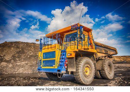 NOVOKUZNETSK, RUSSIA - JULY 26, 2016: Big yellow mining truck at worksite