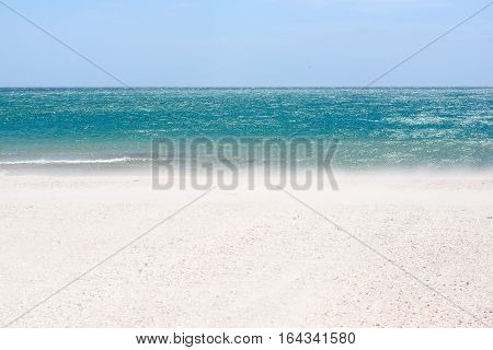 Sea sand sky and summer day. Beautiful tropical beach. Beautiful beach and tropical sea. Seacoast