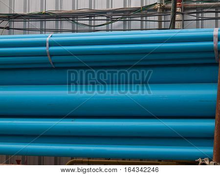 Blue PVC tubes in storage Plastic tubes Background of PVC.