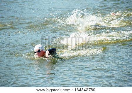 Triathlon Cup of Ukraine and Cup of Bila Tserkva. July 24 2016 in Bila Tserkva Ukraine. Swimmers at a distance