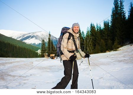A Man Is Photographed On The Background Of Snowy Mountains.