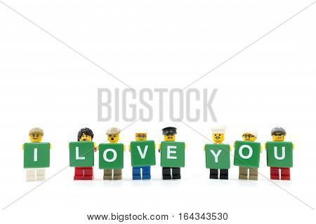 Chiang Mai Thailand - January 8 2017 : Studio shot of LEGO minifigure holding word I LOVE YOU on white background