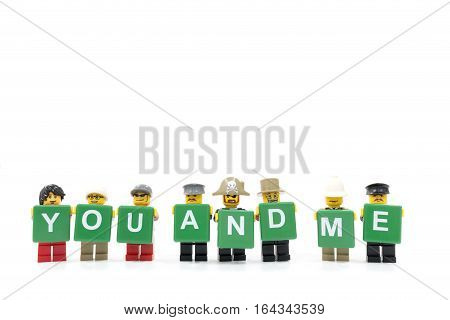Chiang Mai Thailand - January 8 2017 : Studio shot of LEGO minifigure holding word YOU AND ME on white background