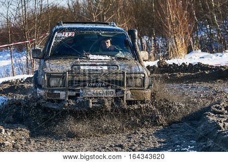 Lviv Ukraine - December 04 2016: Unknown racers on off-road vehicle Toyota overcomes the track at amateur competitions among off-road vehicles near ringroad of the city Lviv Ukraine