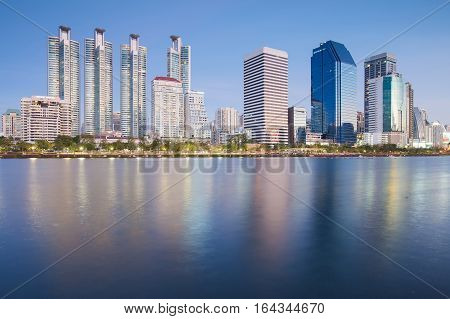 City condominium and office building with water reflection over the lake Bangkok Thailand