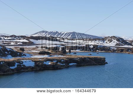 Myvatn volcano over the lake during winter season Iceland natural landscape background