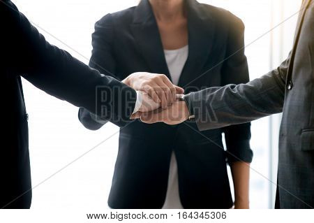 Close up of businesspeople pile hands, close links between business, trade fairly with suppliers, business ventures, exploring new opportunities, approved apply for a loan to start a business concept