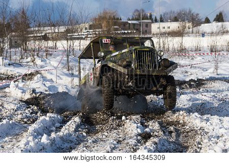 Lviv Ukraine - December 04 2016: Off-road vehicle brand GAZ -69 overcomes the track on a amateur competitions Trial near the city Lviv Ukraine