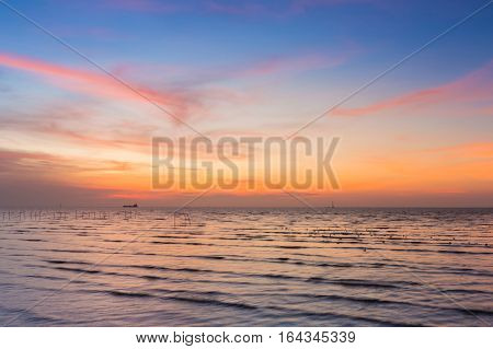 Beauty of sunset over seacoast skyline natural landscape background