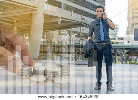 businessman in a suit speaking on smartphone.