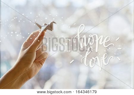 Fabulous paper crane in your hand. Hope Love
