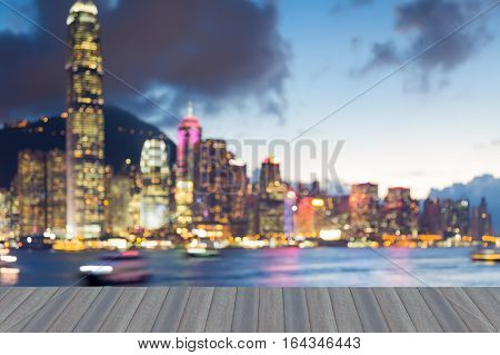 Opeing wooden floor Hong Kong city blurred lights night view abstract background