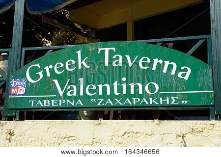 BALI, CRETE - SEPTEMBER 16, 2016 - Greek Taverna Valentino sign on the edge of the beach Bali Crete Greece Europe, September 16, 2016.