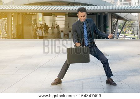 businessman holding a briefcase , powerful businessman