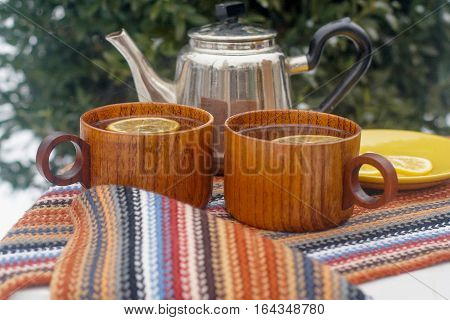 Two Cups Of Tea On A Table In The Winter Garden