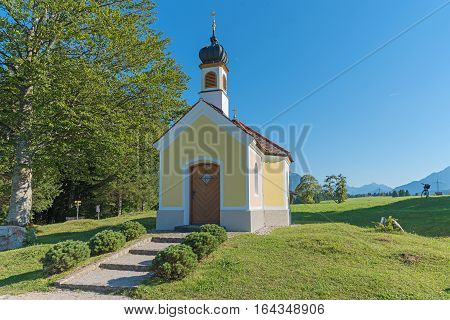 Pilgrimage Chapel And Bench In The Bavarian Alps, Summer Landscape