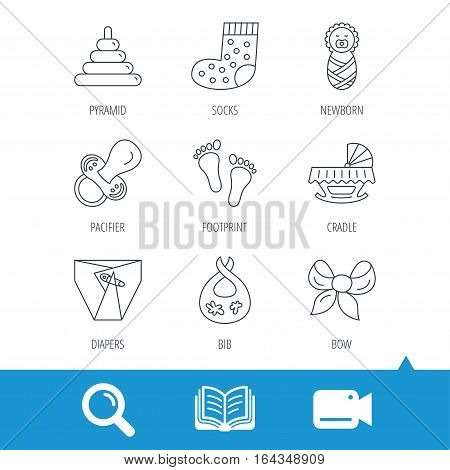 Pacifier, diapers and newborn icons. Footprint, socks and dirty bib linear signs. Pyramid toy, cradle bed flat line icons. Video cam, book and magnifier search icons. Vector
